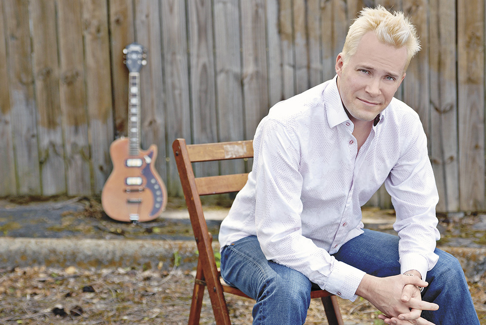 Six strings and a dream: Musician with Charles City roots now an author, too